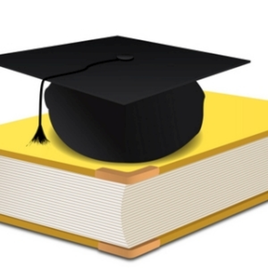 Graduation Hat On Book