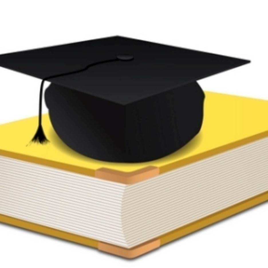 Graduation Hat On Book