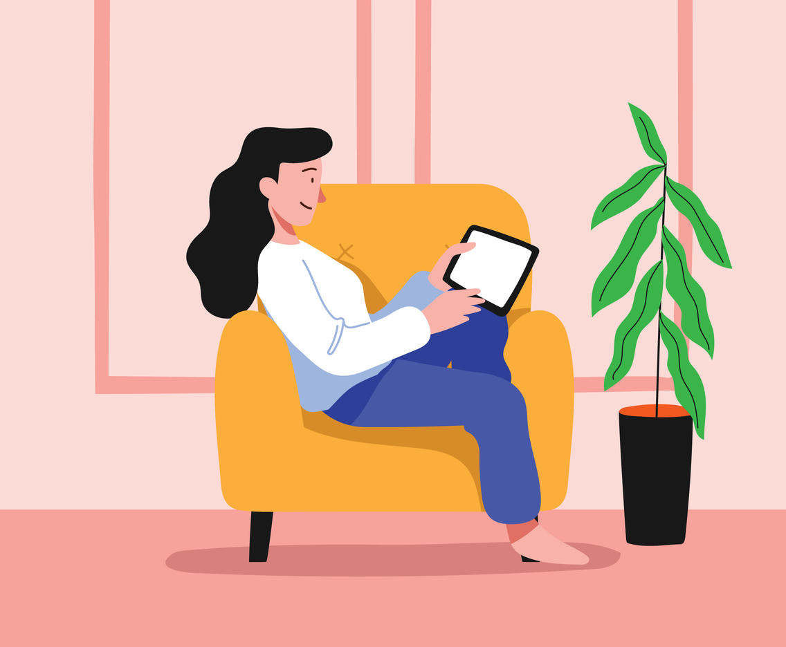 Girl sitting on cozy chair playing with her gadget